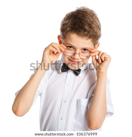 Cute boy in a bow tie and glasses. Isolated on white background - stock photo