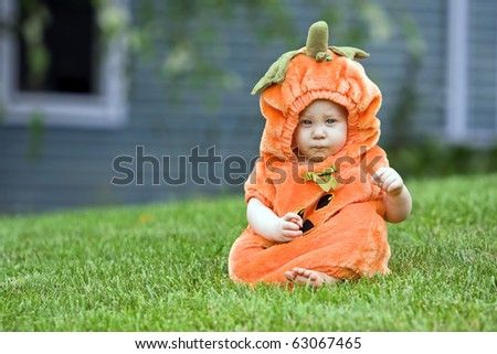 Cute boy in a halloween pumpkin costume