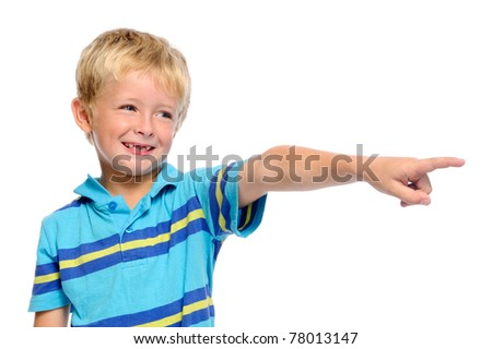 Cute boy in blue shirt pointing at something off frame