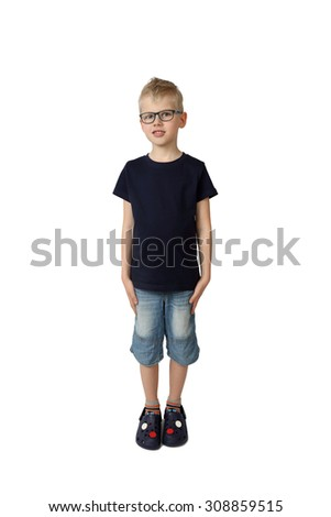 Cute boy in glasses and short jeans stays modestly lowered hands at sides - full height portrait isolated on square white background - stock photo