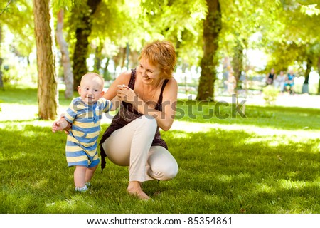 cute boy in nature with mother