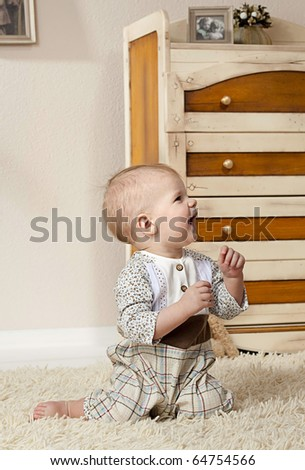 cute boy in the room sitting - stock photo