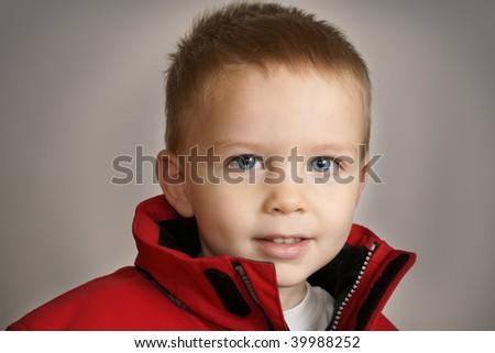 cute boy in winter coat - stock photo