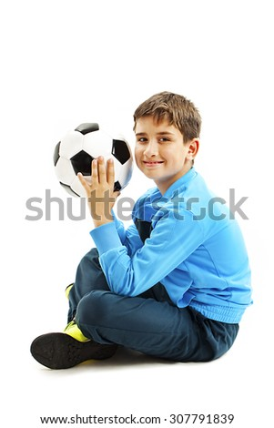 Cute boy is holding a football ball made of genuine leather. Isolated on a white background. Soccer ball - stock photo