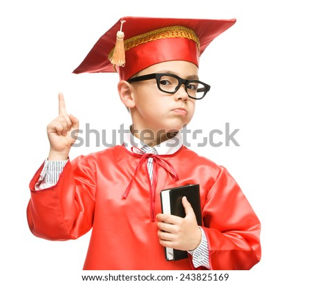 Cute boy is holding book - education concept, isolated over white - stock photo