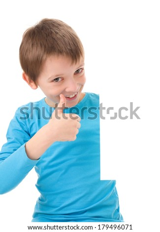 cute boy is looking out from the blank banner and showing thumb up sign, isolated over white - stock photo
