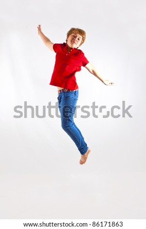 cute boy jumping in the air