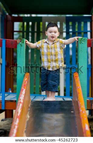 cute boy just before jumping on the slide - stock photo