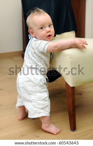Cute boy learning to stand up