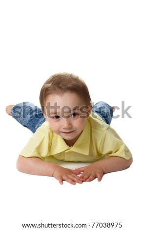 Cute boy lying on floor isolated over white - stock photo