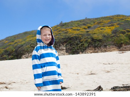 Cute boy on a California state beach - stock photo