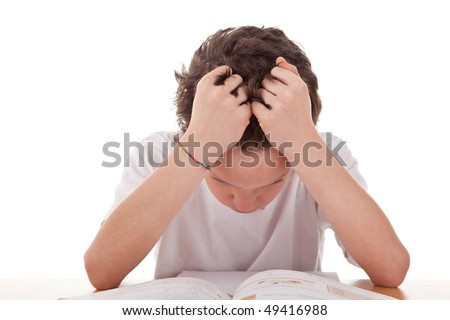 cute boy on the desk studying and despairing - stock photo