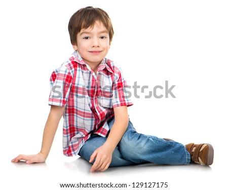 cute boy on the white floor - stock photo