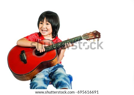cute boy play guitar.lovely kid play music instrument.happy kid love music isolate on white background