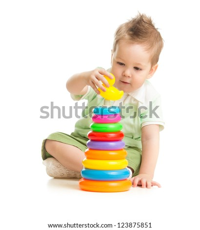 Cute boy playing colorful tower isolated on white - stock photo