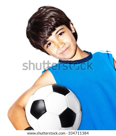 Cute boy playing football, happy child, young male teen goalkeeper enjoying sport game, holding ball, isolated portrait of a healthy preteen having fun, kids activities, little footballer