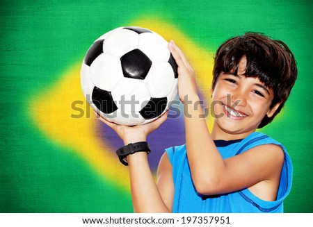 Cute boy playing football, happy child, young male teen goalkeeper enjoying sport game, holding ball, portrait of a preteen smiling and having fun, kids activities, little footballer