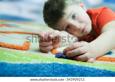 Cute boy playing in his room