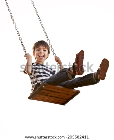 Cute boy playing on swing, having fun.  On a white background. - stock photo