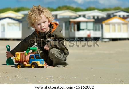 cute boy playing on the beach
