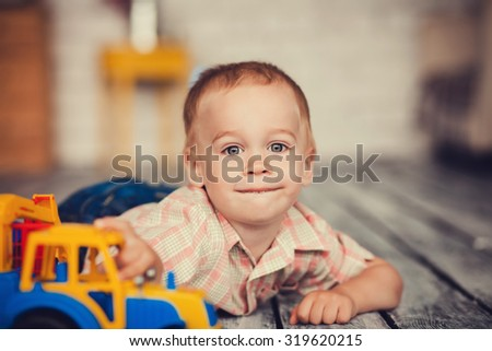 cute boy playing with a toy car. close-up portrait