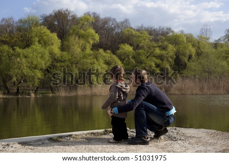 Cute boy playing with his father - stock photo