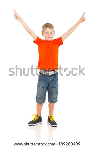 cute boy pointing at empty copyspace isolated on white - stock photo