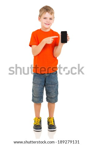 cute boy pointing at smart phone on white background - stock photo