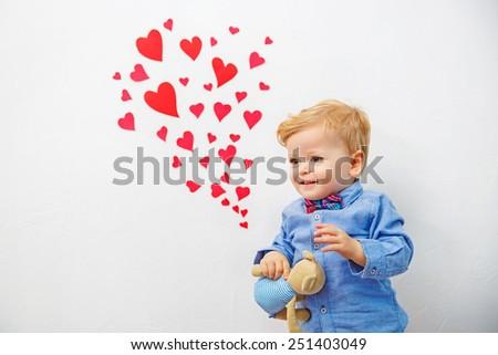 cute boy preparing for Valentine's Day - stock photo