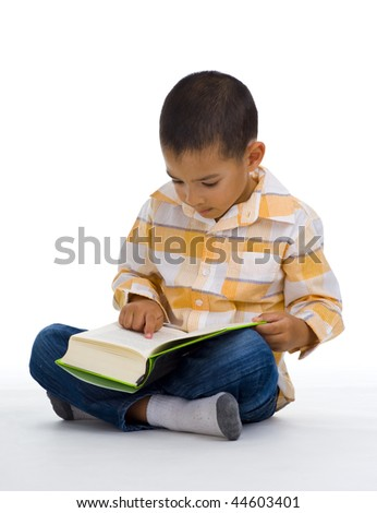 cute boy reading a book, isolated on white - stock photo