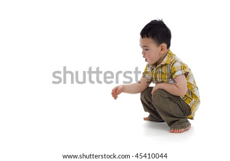 cute boy sees something interesting, isolated on white - stock photo