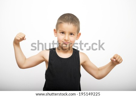 Cute boy showing muscles - stock photo