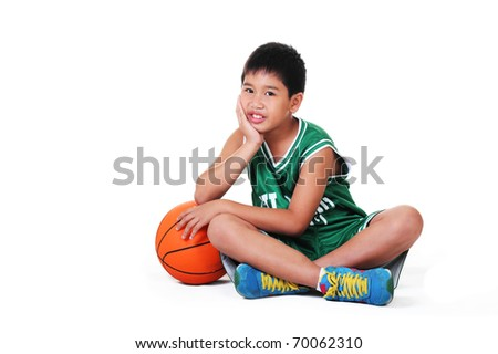 cute boy sitting and relaxing on the floor.white background. - stock photo