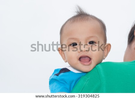 Cute boy smiling brightly. White space backdrop. 10-month-old baby