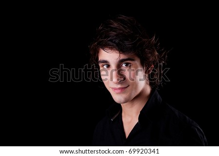 cute boy, smiling on black, studio shot - stock photo