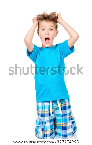 Cute boy stares into the camera and shouting. Isolated over white background. - stock photo