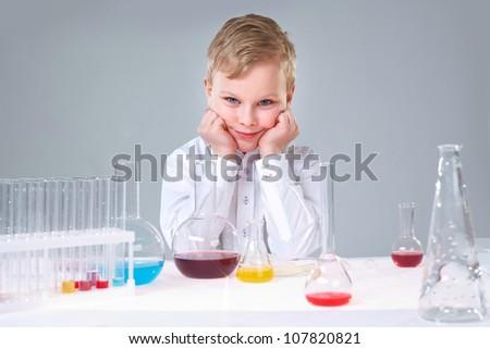 Cute boy taking part in the school scientific project - stock photo