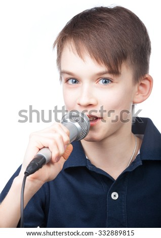 Cute boy wearing blue polo speaking to microphone on white background - stock photo