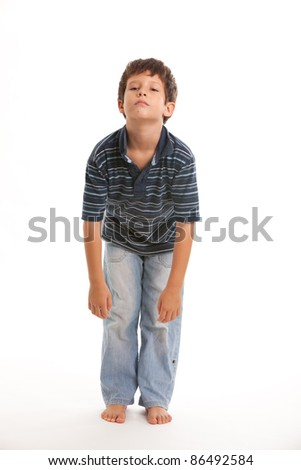 Cute boy with a bored expression on a white background. - stock photo