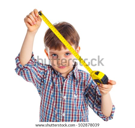 Cute boy with a building roulette. Isolated on white backrownd. - stock photo