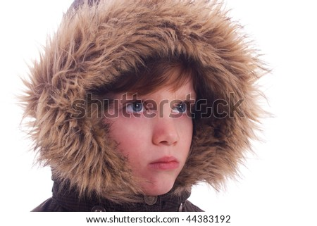 Cute boy with a furry hood