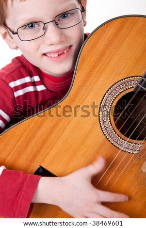 Cute boy with a guitar, isolated on a white background
