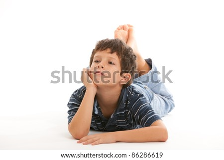 Cute boy with a thinking expression on a white background. - stock photo