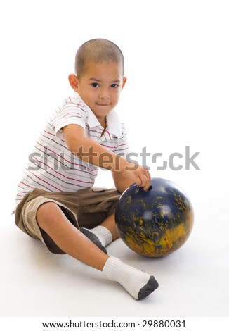 cute boy with bowling ball - stock photo