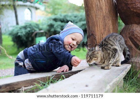 cute boy with cat - stock photo