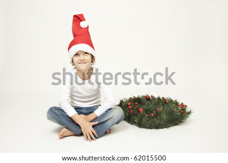 Cute boy with christmas decorations - stock photo