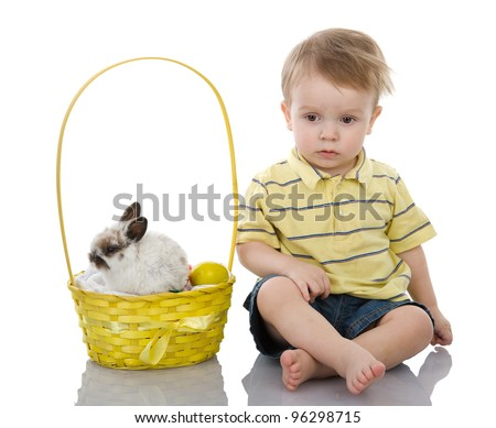 Cute boy with easter eggs and Lop-eared easter bunny.  isolated on white background