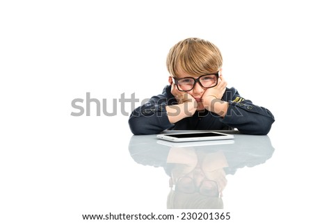 Cute boy with glasses and digital tablet on white background - stock photo
