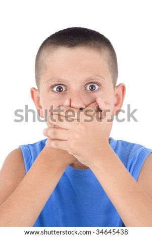 cute boy  with  hands covering  mouth as if in horror - stock photo