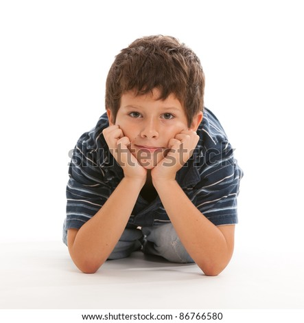 Cute boy with hands on face on a white background.